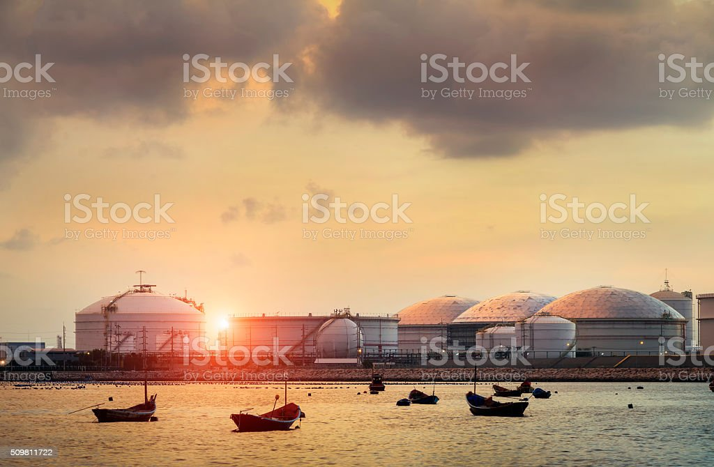 Natural Gas storage tanks and oil tank  at twilight stock photo