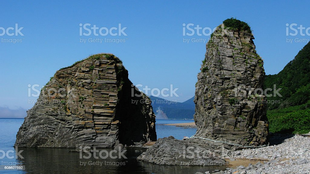 Natural gate in cape Stolbchatiy stock photo