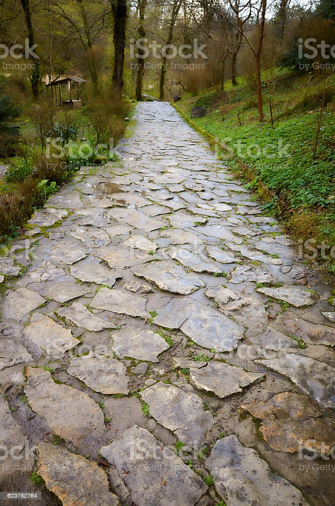 Natural gray old stone grunge pavement texture background stock photo