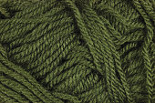 Natural green fine wool threads texture, horizontal skein clew background