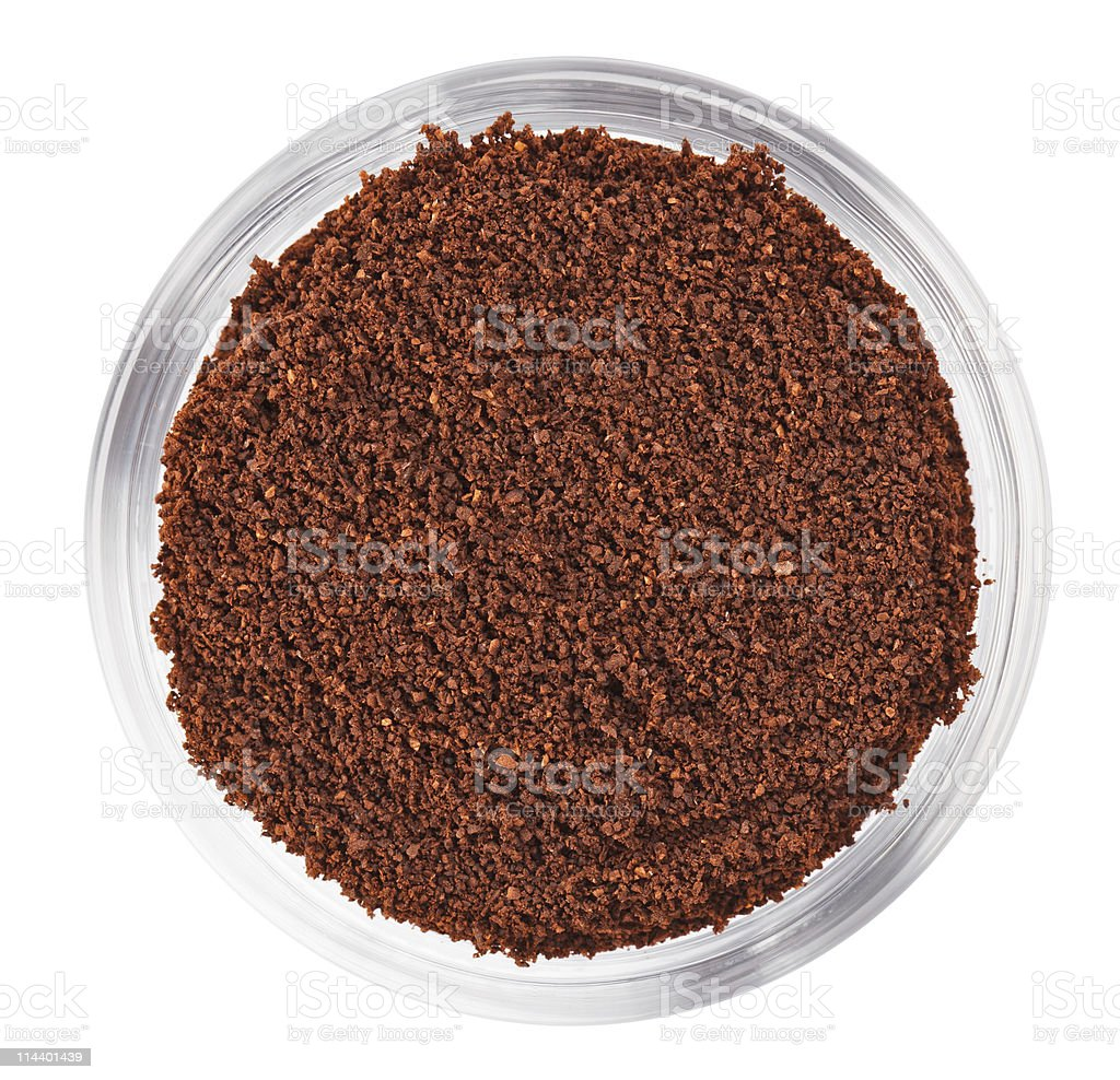 Natural ground coffee heap in transparent glass bowl royalty-free stock photo