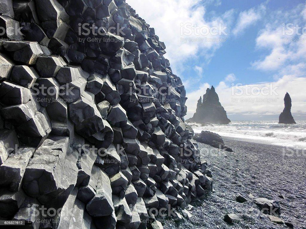 Natural hexagonal basalt columns geological feature on Icelandic coast stock photo