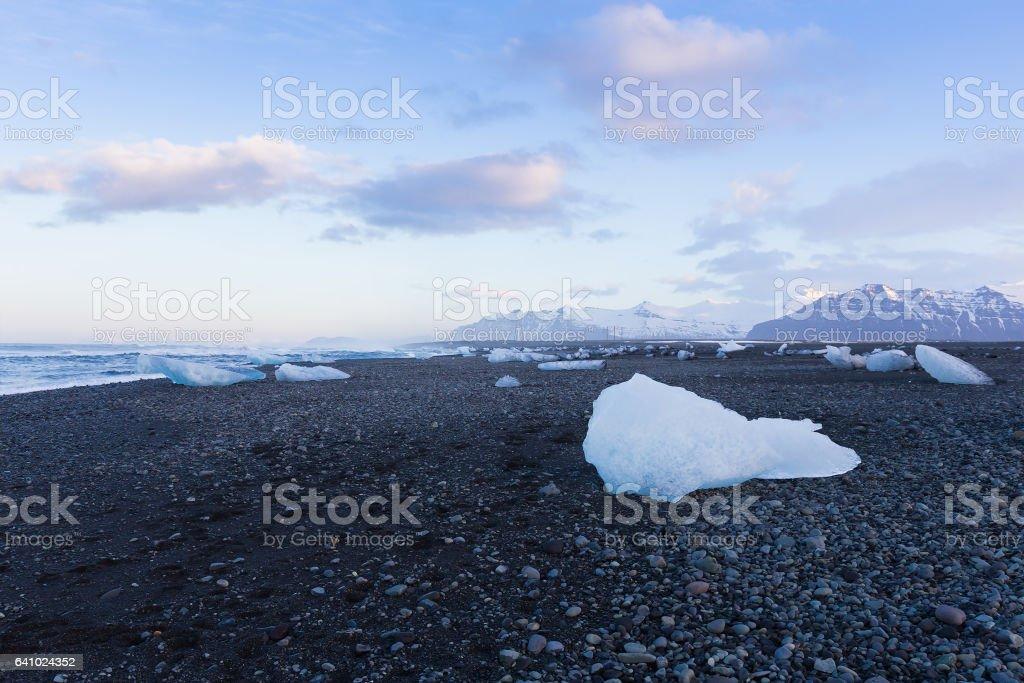 Natural ice on black sand beach skyline stock photo