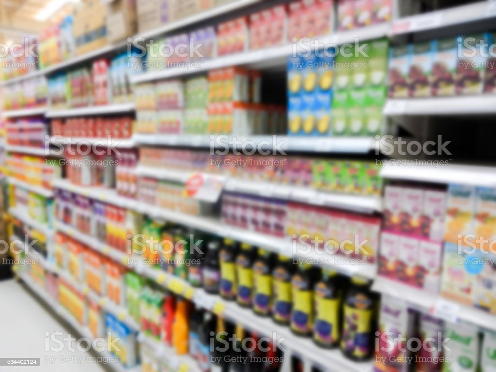 Natural Juice Bottles on Supermarket blurred background stock photo