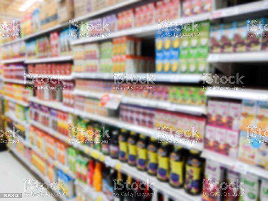 Natural Juice Bottles on Supermarket blurred background stock photo