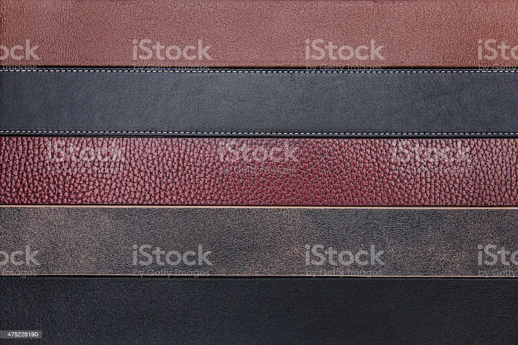 Natural leather belts close-up texture background stock photo