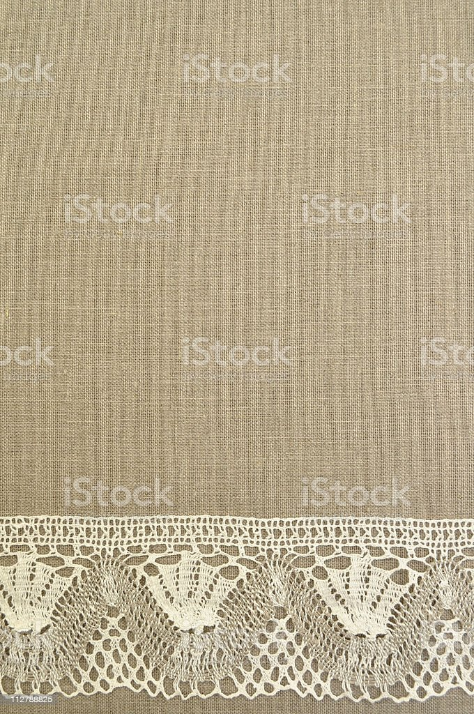 Natural linen background with lace royalty-free stock photo