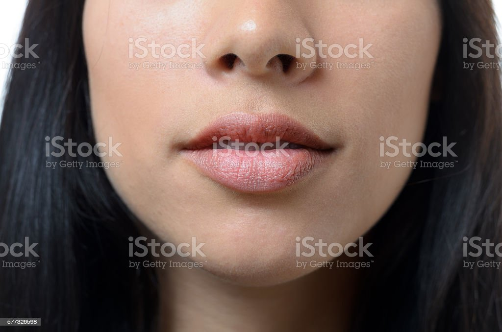 Natural lips and mouth of a young woman stock photo