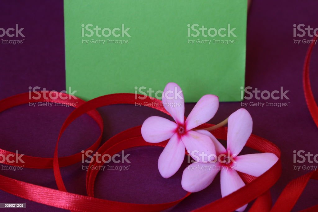 natural looking Label with bright flower ribbon on purple stock photo