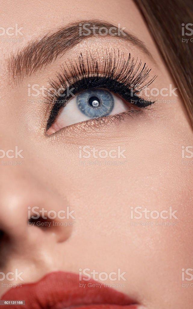 natural makeup on blue eye stock photo