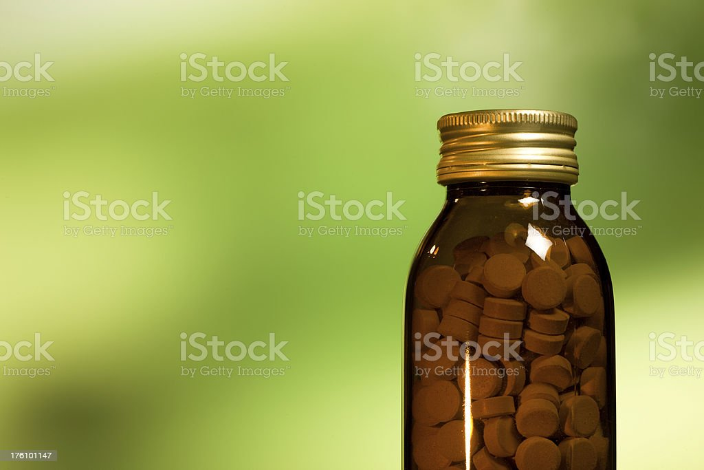 natural medicines, pills,glass bottle stock photo
