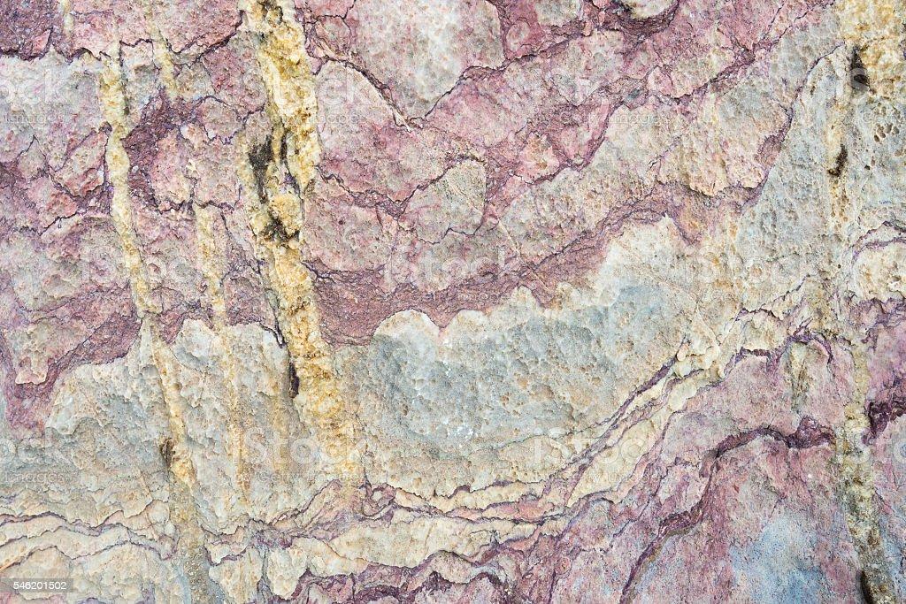 Natural multi colored metamorphic rock background stock photo