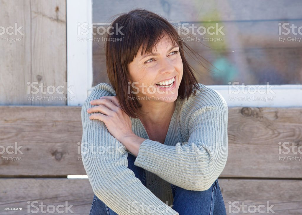 Natural older lady smiling outside stock photo