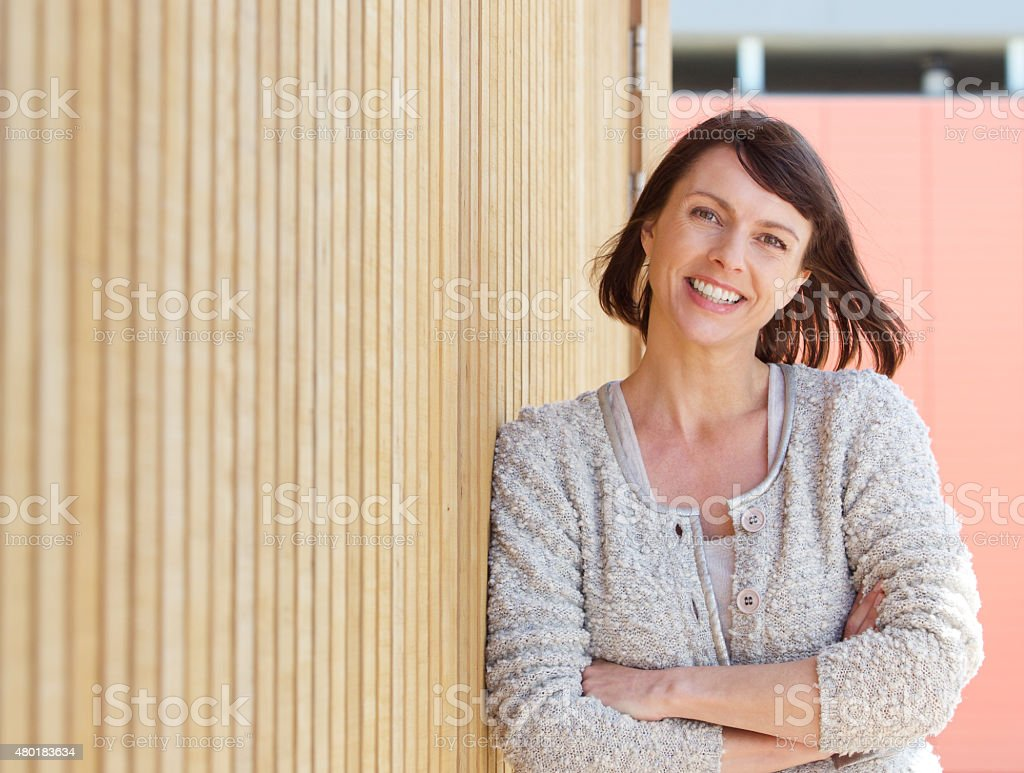 Natural older woman smiling stock photo