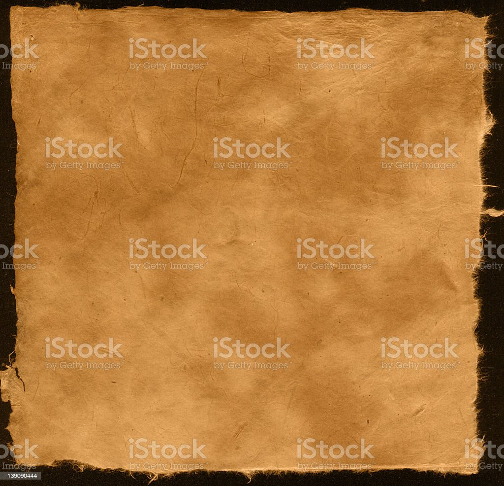 Natural organic textured paper on a black background royalty-free stock photo