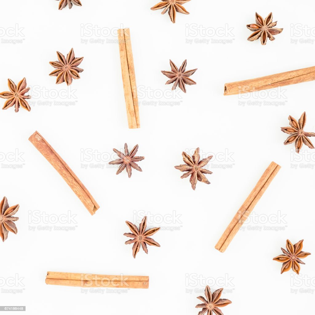 Natural pattern of cinnamon and anise tree on white background. Spice. Flat lay. Top view. stock photo