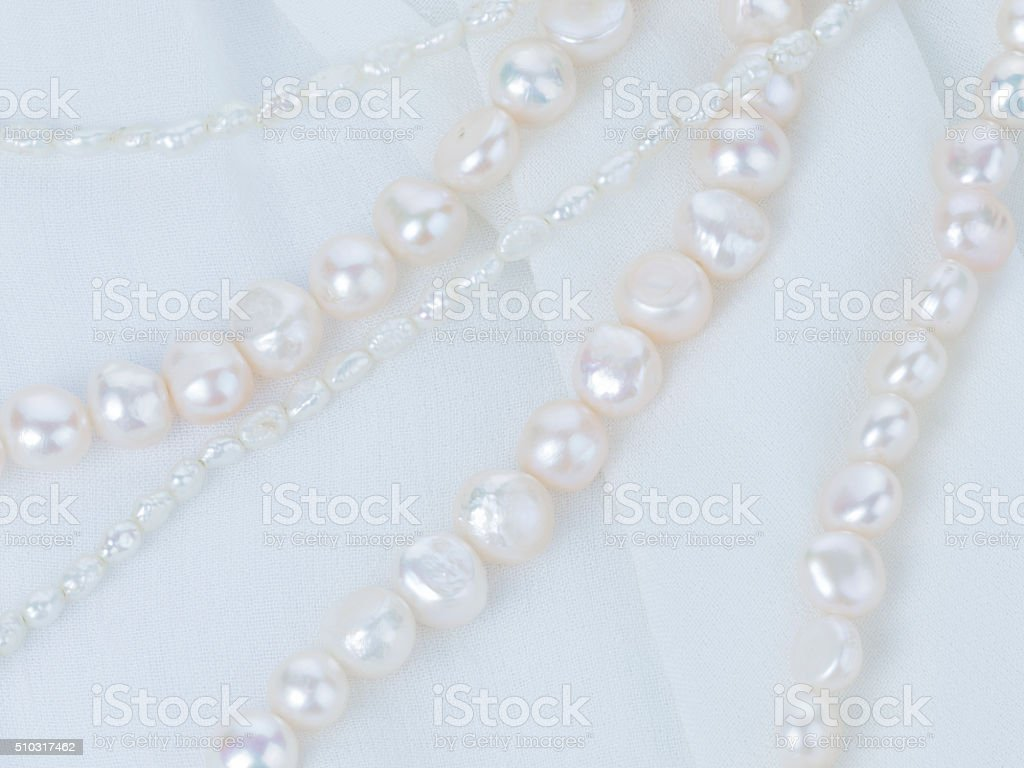 natural pearl necklace of white pearls stock photo