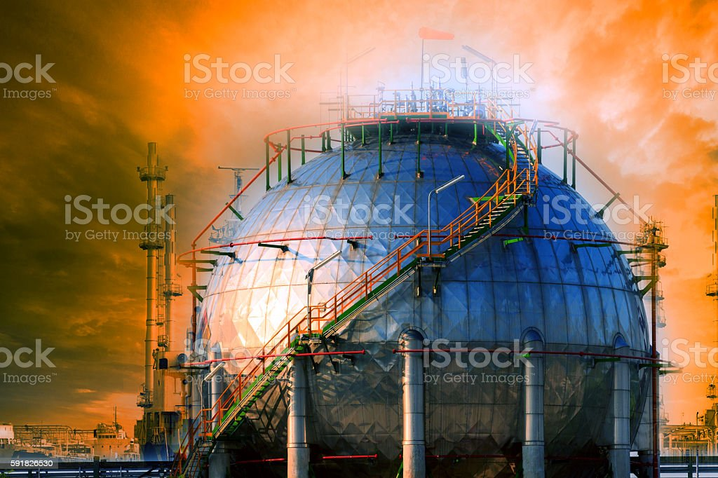 natural petrochemical gas storage tank in heavy petroleum industry estate stock photo
