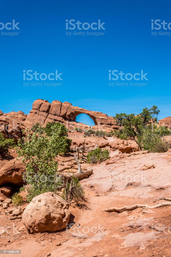 Natural picturesque stone arches in the Moab Desert stock photo