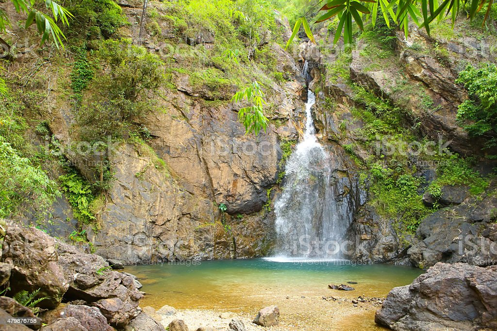 Natural pool at Jokkradin waterfall in Kanchanaburi, Thaialnd. stock photo