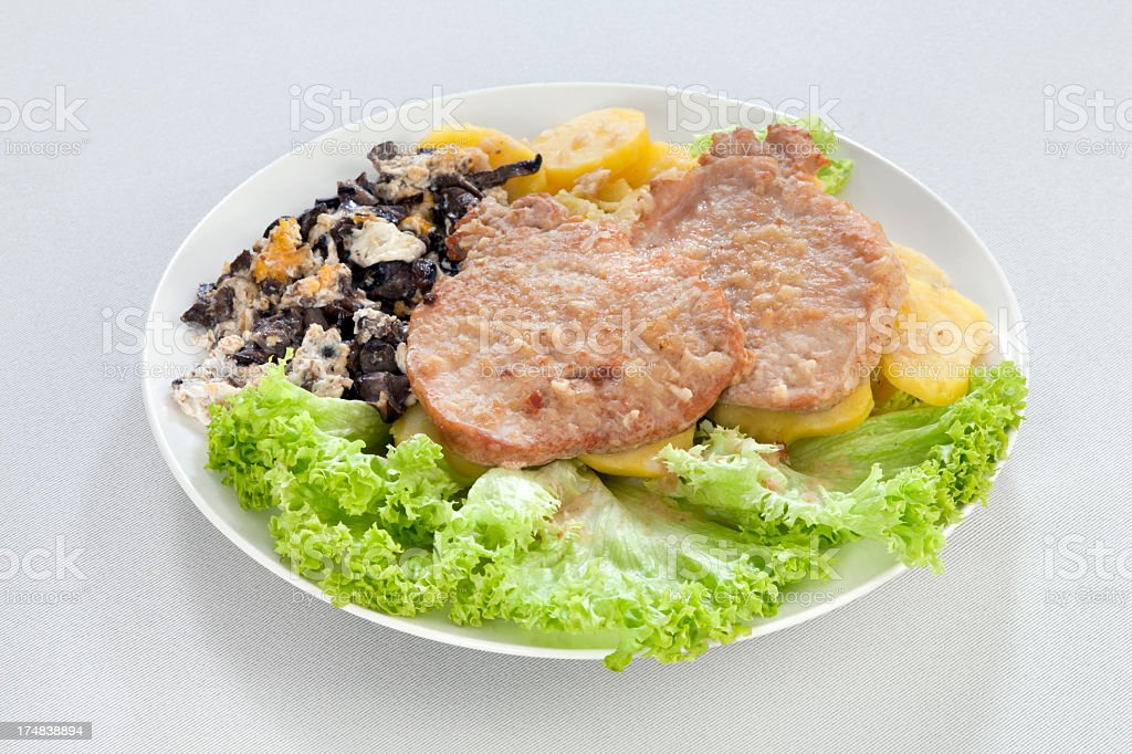 Natural pork cutlet with scrambled eggs royalty-free stock photo