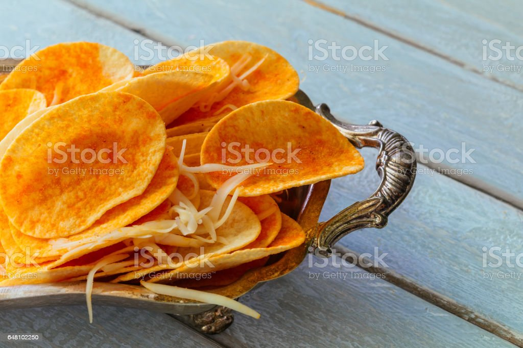 Natural potato chips heap the bowl on wood background stock photo