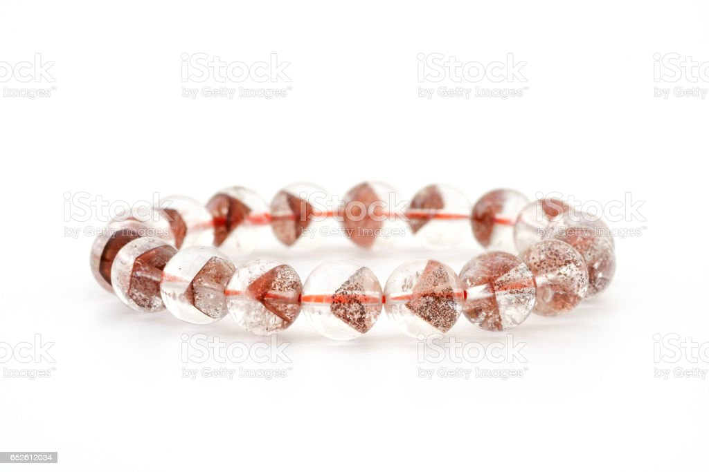 Natural rare Pyramid - shaped mineral inside crystal Quartz beads in bracelet on white background stock photo