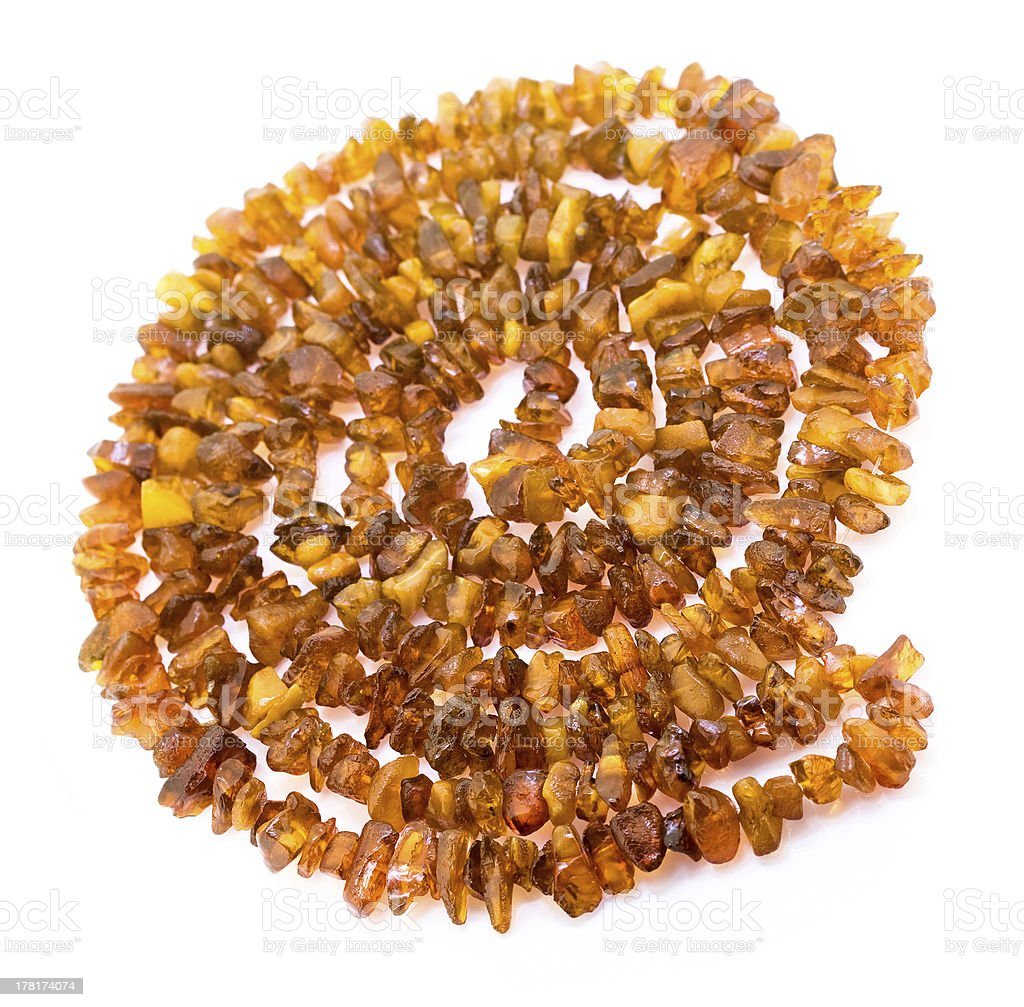 Natural raw amber necklace on the white background. royalty-free stock photo