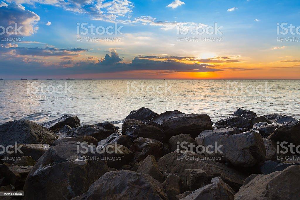 Natural sea rock over the beach stock photo