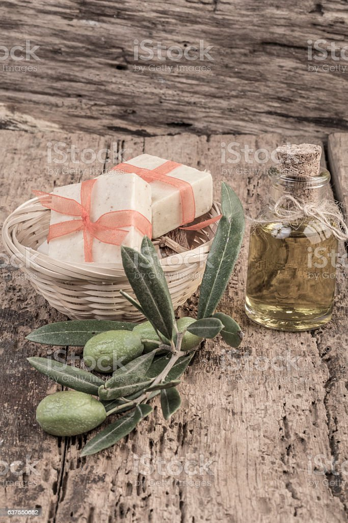 natural soap bars and olive oil bottle on wooden table stock photo