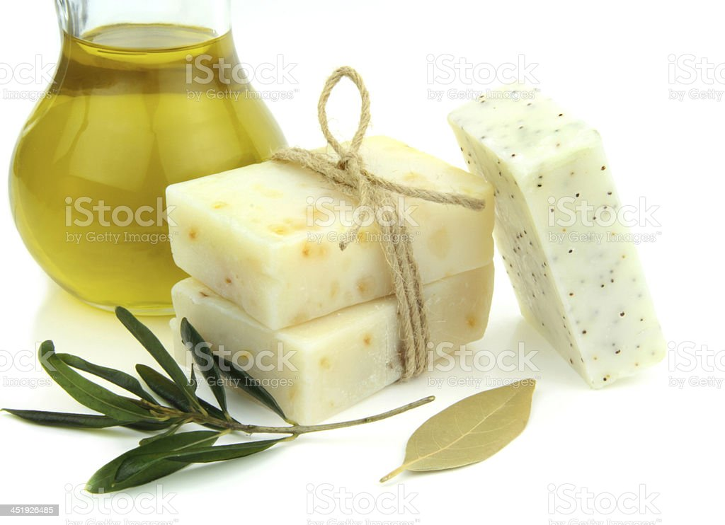 Natural soap bars with olive, daphne and poppy seeds stock photo