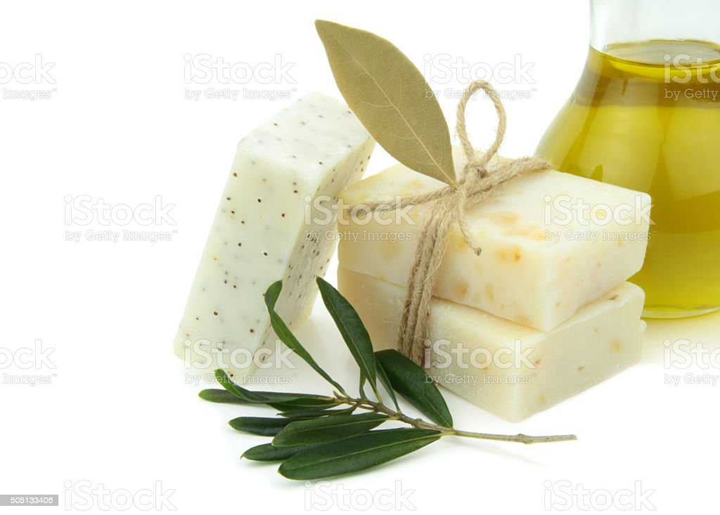 Natural soap with olive oil, daphne and poppy seeds stock photo