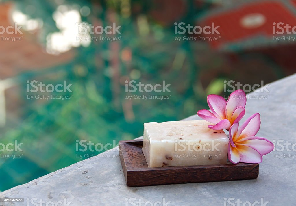 Natural soap with swimming pool background royalty-free stock photo