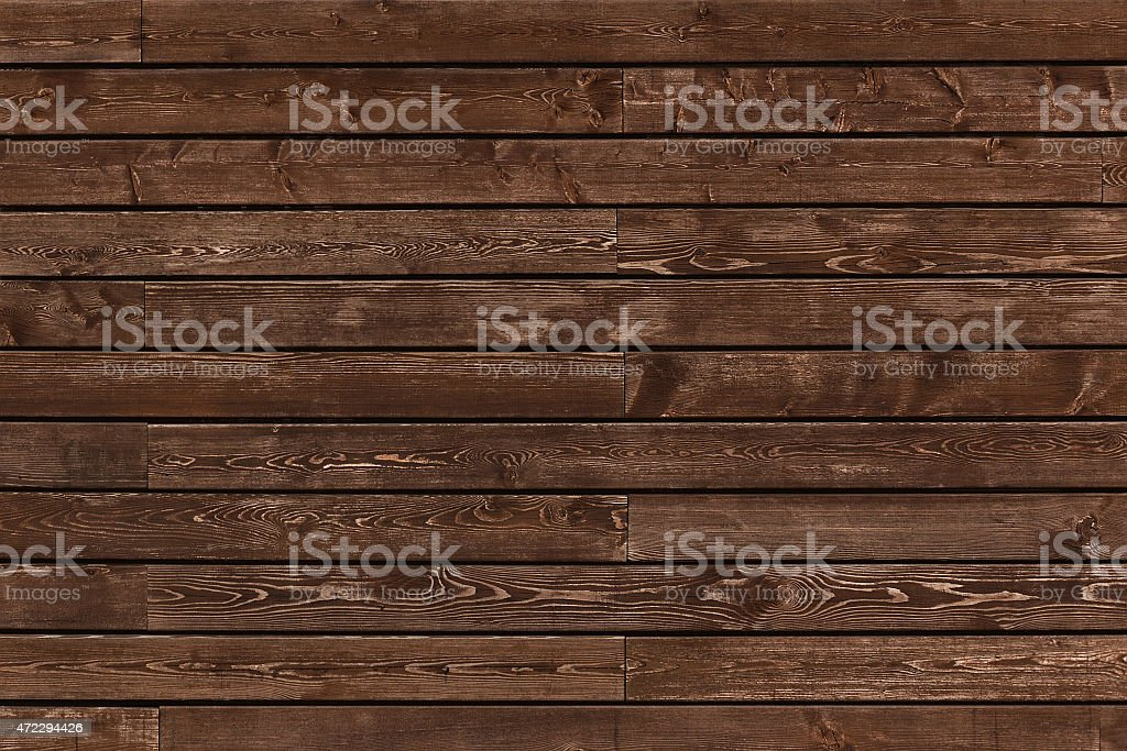Natural stained wooden background with groves between planks stock photo