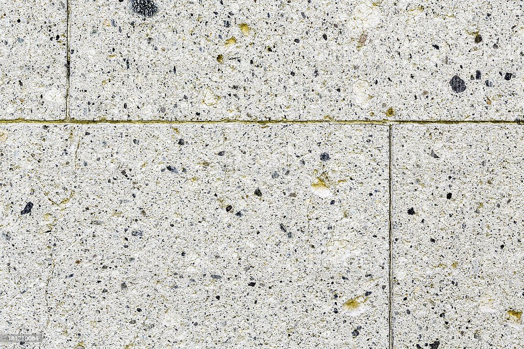 natural stone granite wall with rough structure stock photo