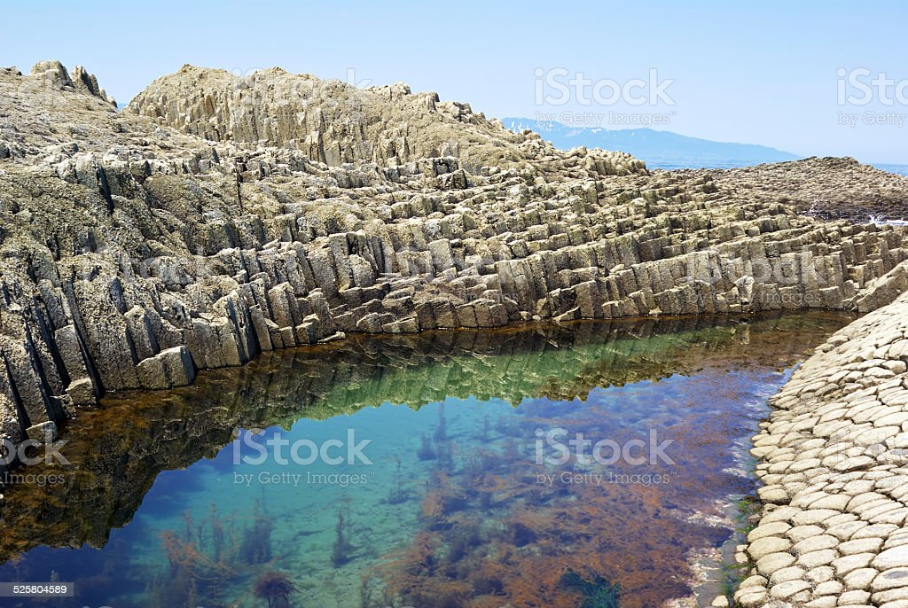 Natural stone sea water stock photo