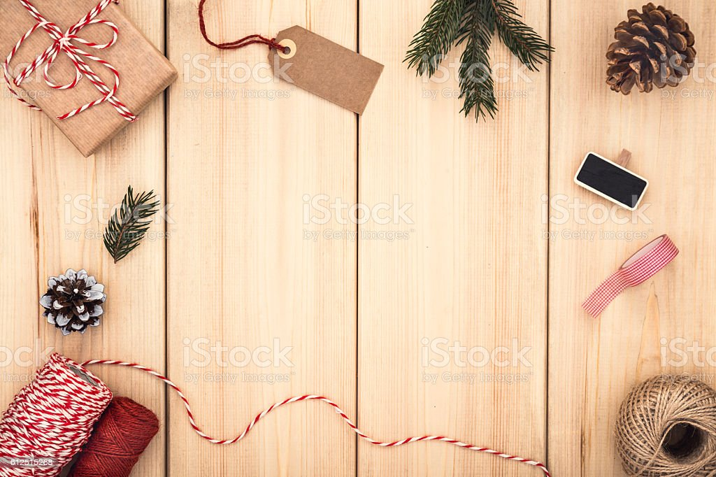Natural style handcrafted gift box on wooden background. Packaging ideas. stock photo