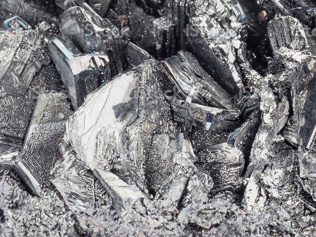 Natural unusual gray-black stone cassiterite stock photo