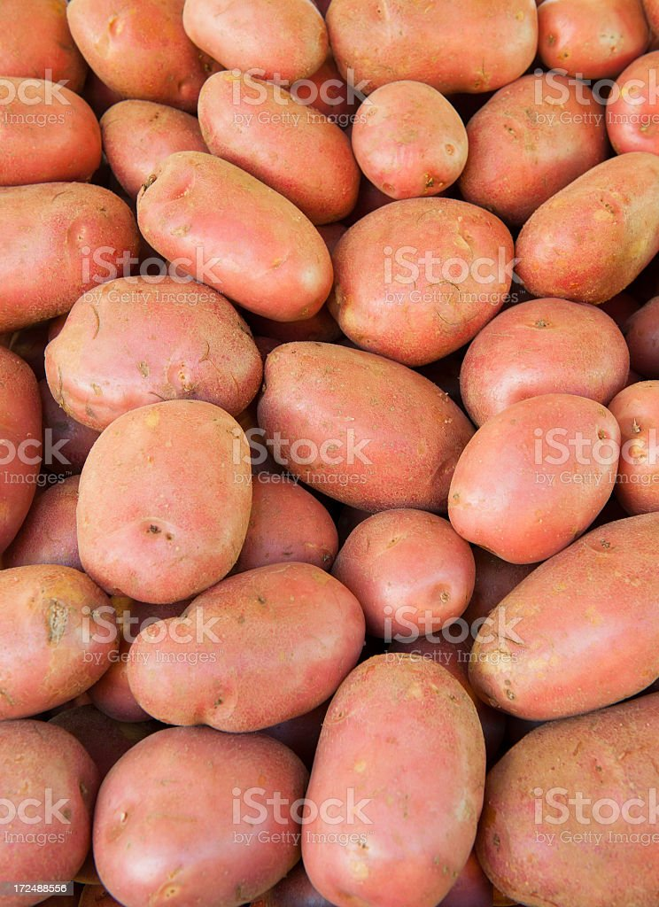 Natural vegetables on market stall: red potatoes royalty-free stock photo