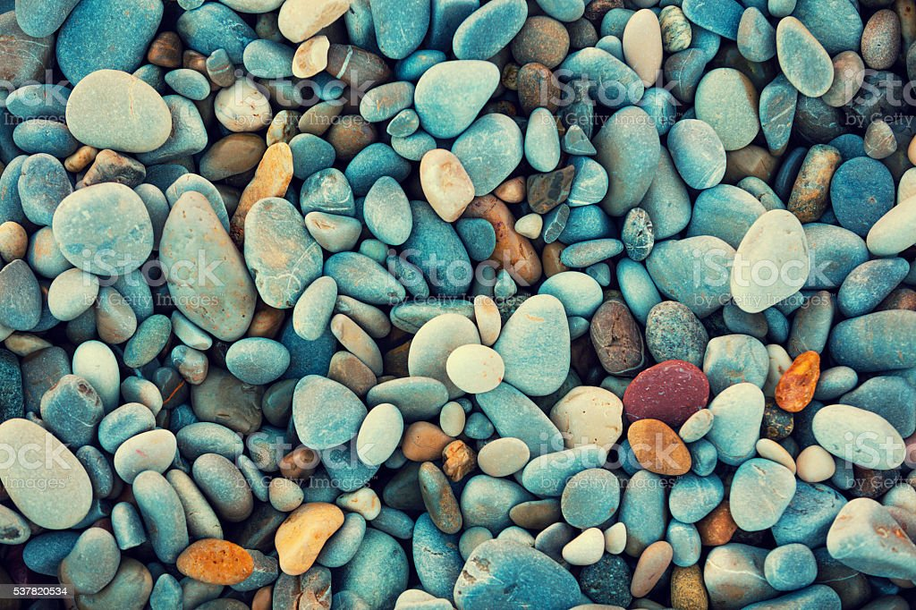 Natural vintage colorful pebbles background stock photo