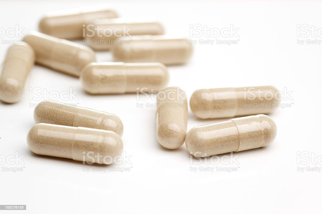Natural Vitamin supplements on white royalty-free stock photo