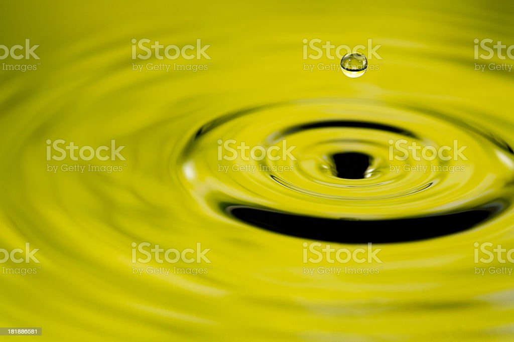Natural water scene with levitate drop and ripples royalty-free stock photo