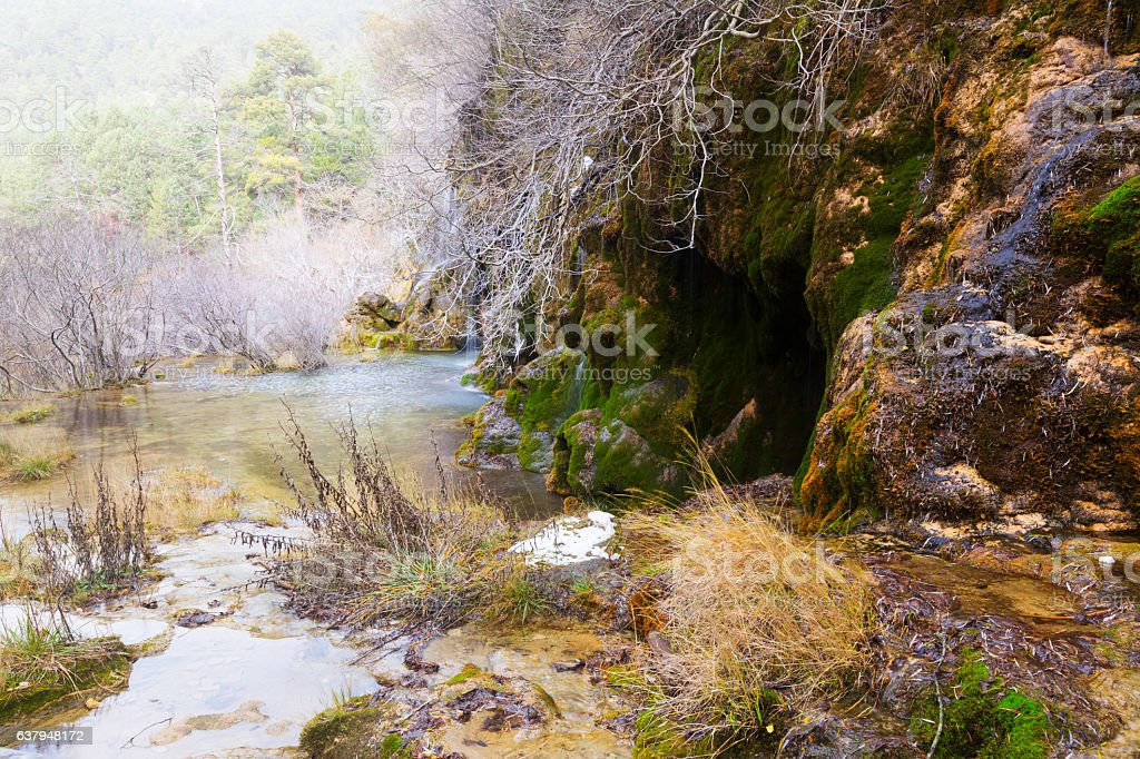 Natural   waterfall at river Cuervo in winter stock photo