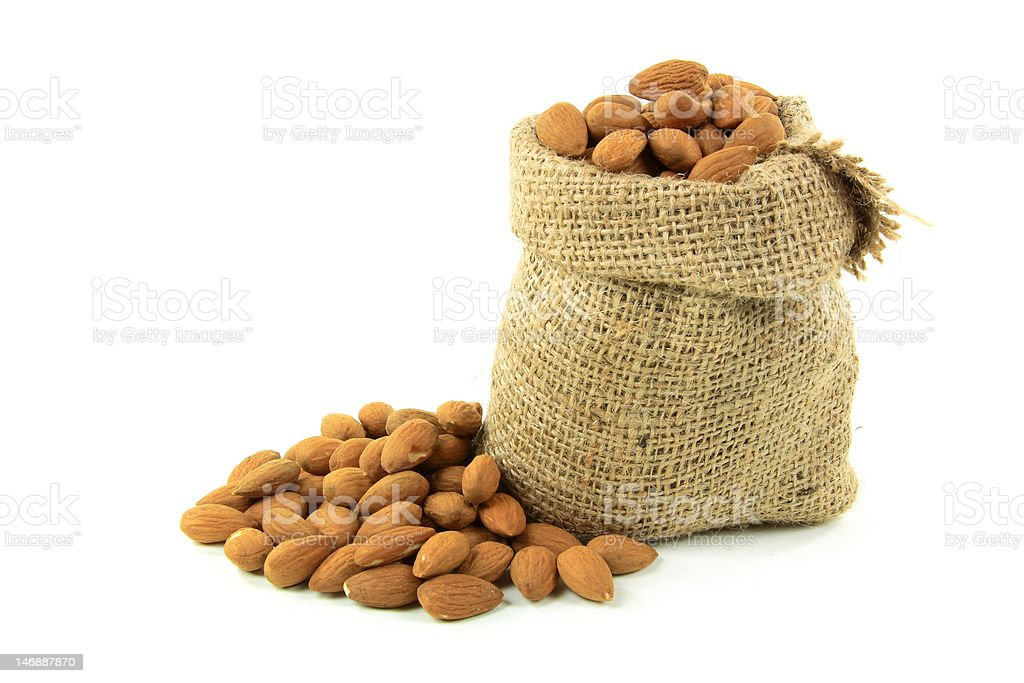 Natural Whole Almonds nuts in burlap bag royalty-free stock photo