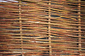 Natural wicker fence made of thin willow twigs