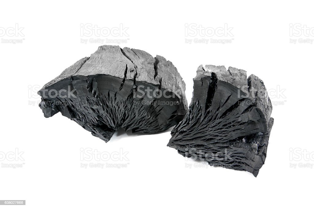 Natural wood charcoal isolated on white background. stock photo