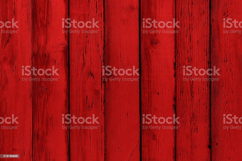 Natural wooden painted red boards, wall or fence with knots stock photo