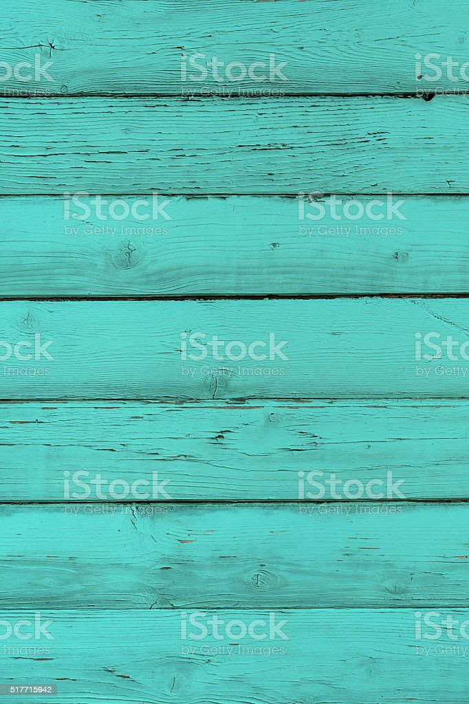 Natural wooden turquoise boards, wall or fence with knots stock photo