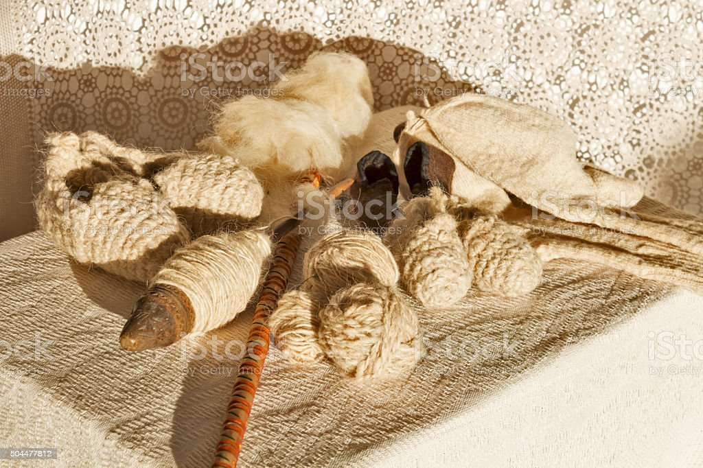Natural wool socks and antique wool spinning tools stock photo