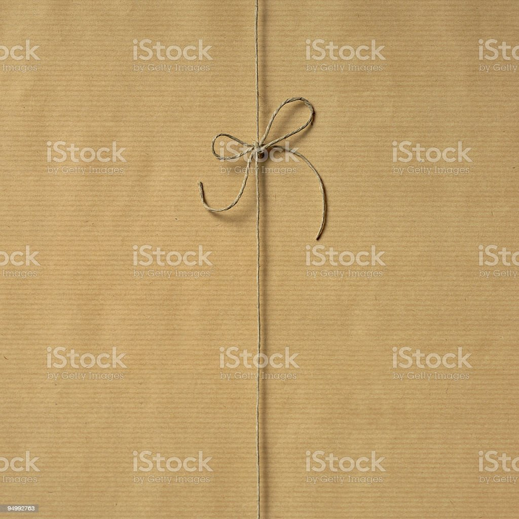 Natural wrapping paper with natural string to package stock photo